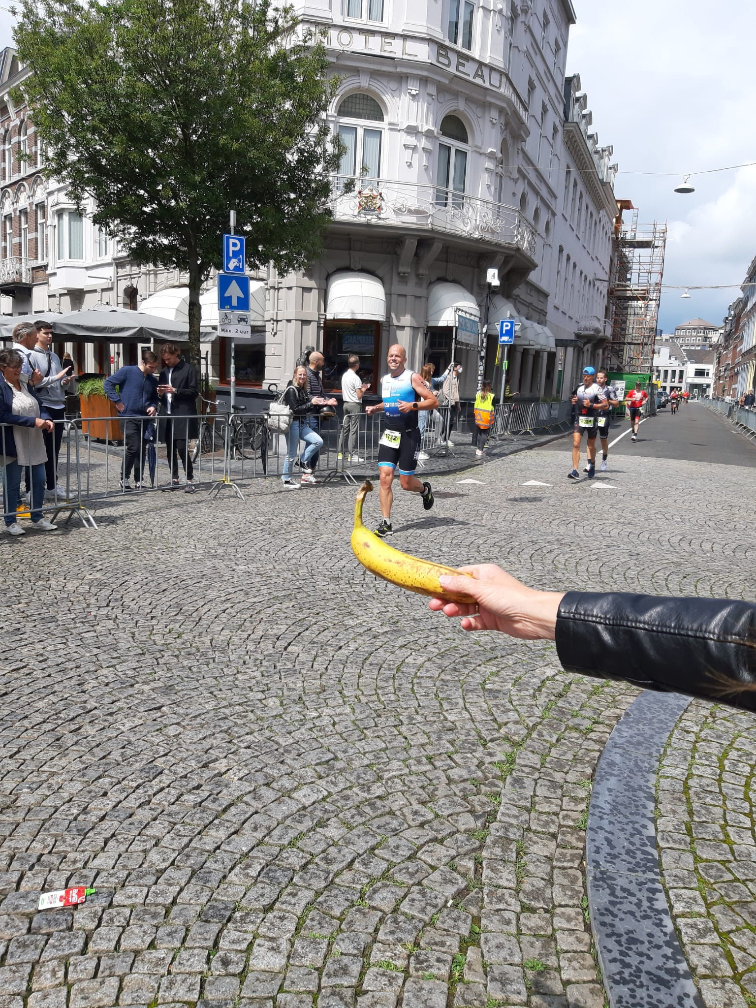 A person holding a banana  Description automatically generated with medium confidence